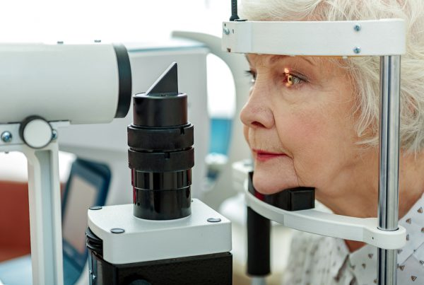 elderly woman at eye doctor