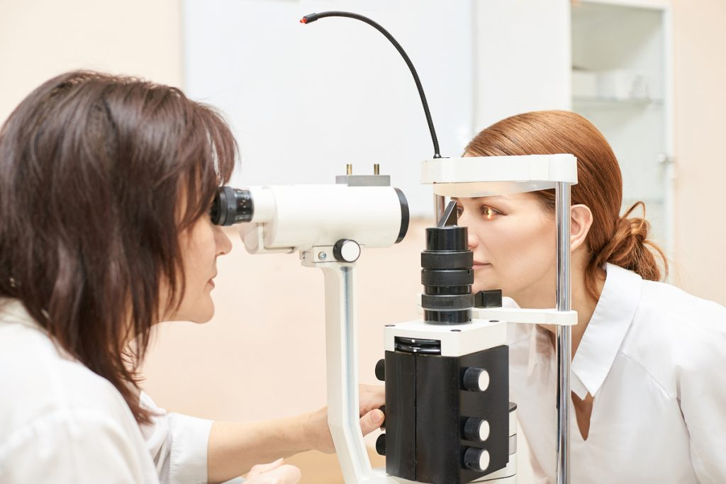 Ophthalmologist examining patients eye