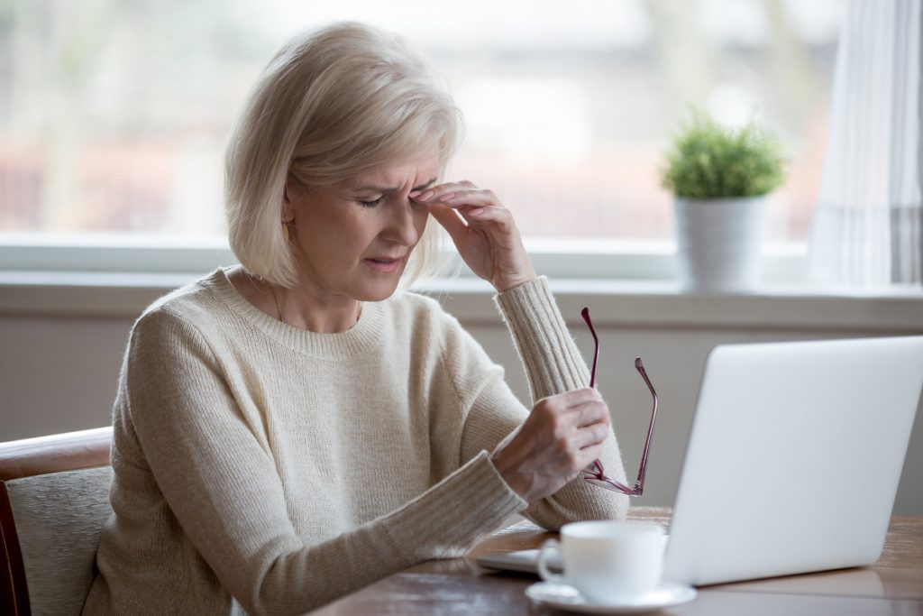 elderly woman having eye problems